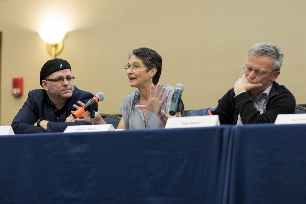 Closeup of three panel members